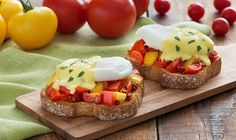 The colourful tomatoes star in this flavourful twist on a perennial brunch favourite.