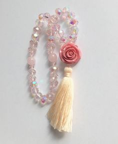 This is a beautiful pink colored tasbih with rose quartz separators and a pink stone rose. The beads are 10mm in size and fit rather nicely in the hand. It makes them the perfect gift for your grandmother this Eid. This very special tasbih will remind her of you every time she says her prayers