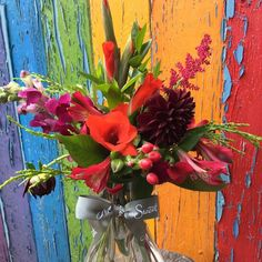 Bright reds posy of British flowers such as dahlia, gladioli, snapdragon and scabious by www.meadowsweet.co.uk