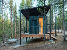 """The Outward Bound cabins' steel frames lift the structures above a three-foot snowpack while supporting corrugated-steel """"snow roofs."""""""