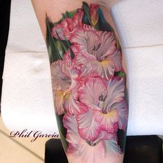 Beautiful realistic Gladiolus flower tattoo by the always amazing @philgarcia805