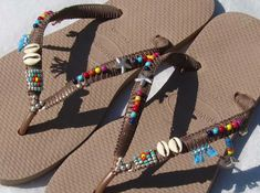 Multi Colored Beaded Bohemian Flip Flop Handmade Decorated Sandals based on Rose Gold Havaianas Flats - 100% Handmade. You can decorate your hands, ears, neck but also … your feet! These are an absolutely unique Must Have Flip Flops!!! The combination between style and comfortable at the same pair of sandals. By decorating I used professional jewelry techniques and the highest quality materials varying from japanese beads, sterling silver beads, stone beads, shells and other beautiful…