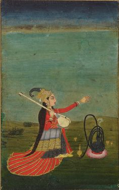 This female musician plays a tanpura, a long-necked string instrument used in Indian music. Listen to more traditional tunes on our podcasts page.