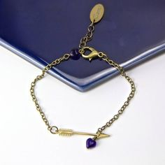 Gama Arrow Bracelet ($17) ❤ liked on Polyvore featuring jewelry, bracelets, chains jewelry, golden jewelry, heart-shaped jewelry, cobalt blue jewelry and heart bangle