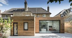 Exterior - rear extension with a bifold door and light timber cladding