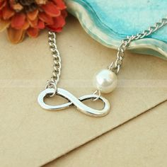 Etsy shop that has lots of infinity bracelets - gift for girls?    http://www.etsy.com/shop/mosnos