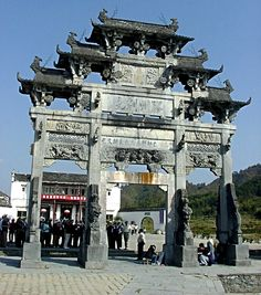 A stone carving memorial archway in Xidi, a mountain village built in the early Ming Dynasty in Anhui Province China Architecture, Sacred Architecture, Amazing Architecture, Lijiang, Shenyang, Hangzhou, Grand Canal, Chinese Gate, Chinese Courtyard