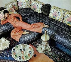 Model lounges in caftan-like pajamas by Talmack, photo by Howell Conant at the Moroccan embassy, 1966