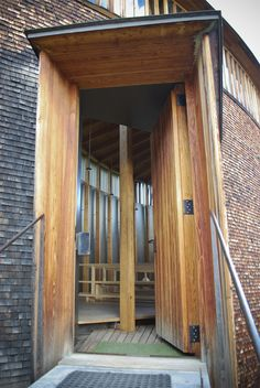 The door was an extremely interesting element, from the long vertical slats to the metal door handle that felt just right for the silent procession into the heart of the building.
