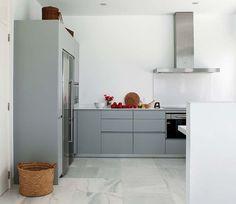 Love the colour of the kitchen cupboards. Quite unusual actually.   via Planète Déco