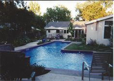 This custom lap pool was built for a lawyer and her son...she wanted to do laps on one side and have a separate,deeper area for him to enjoy.  The long side is 10'x40' and the other area was 18'x18'.  There was a nice waterfall wall with two sheer descents.