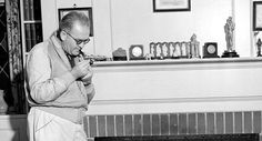 With an Oscar statuette displayed on the mantelpiece, director John Ford is shown at his home in this undated photograph. Best Director, Film Director, Preston Sturges, Best Picture Nominees, Georgian Style Homes, William Wyler, Grapes Of Wrath, The Hollywood Bowl, John Ford