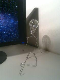 Ogni cosa è illuminata  Material: hanger, wire, bulb and permanent marker  Dimensions: 25 cm  made by FOP