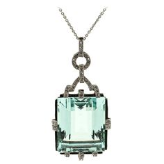 1940s Aquamarine Diamond Platinum Pendant. This beautiful Art Deco Aquamarine pendant is set in platinum and accented with small Rose Cut Diamonds and black enamel borders. It hangs from a 18 inches long 14KT white gold cable link. It measures 2 inches long by 7/8 wide. Circa 1940's.