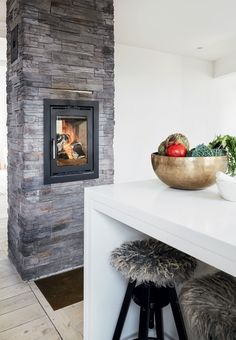 Nordic and modern built in fireplace in the kitchen.