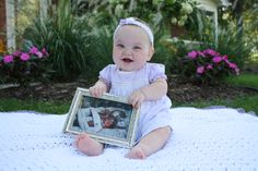 Preemie First Birthday Photo Idea.  Hold a photo of the baby in the NICU
