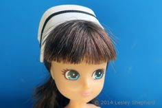 How to make a traditional nurse's cap custom fitted to any head size. Shown in miniature scale for dolls.