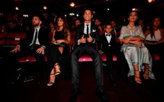 Nominees for the Best FIFA football player, Barcelona and Argentina forward Lionel Messi (L) with his wife Antonella Roccuzzo (2nd L) take their seats next to Real Madrid and Portugal forward Cristiano Ronaldo (C), his son Cristiano Ronaldo Jr (2nd R) and his partner Georgina Rodriguez