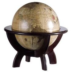 "Classic globe in a wood ring stand.    Product: Globe with stand    Construction Material: Wood Color: Multi          Dimensions: 11"" H x 10.5"" Diameter"