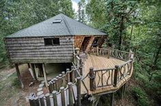 """On a forest hilltop in Mississippi sits this treehouse among southern magnolias, maples and white oak. It's easy to picture the builder, late artist Johnny Knight, sitting with a dog-eared copy of """"The Hobbit"""" and coming up with this enchanted dwelling. Back in 1971, he set massivecypress stumps in a clearing and erectedan octagonal 1-bedroom, 1-bath house atop them. The current owner bought the treehouse after Johnny died, bolstered the structure and added flourishes like a…"""