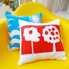 My daughter screen printed this red cushion using simple paper cut stencils- similar projects are found in my Fun With Fabric book published by PAVILION