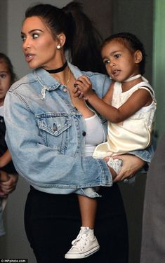 Too cute:North was darling in a yellow and white dress with white choker and white high top sneakers