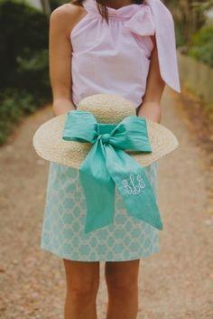 Wide-brimmed beach hat with monogrammed sash.