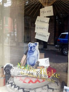 I like the saying and the concept....hate the stuffed pillow as a dog.  But other than that, I like the window/display design!