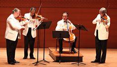 string quartet in white jackets, black tie.