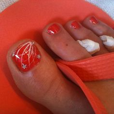 "4th of July Glitz. Fireworks nail art design over Sation ""Red Hot Orange"". Nail Art & Pedicure 
