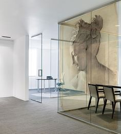 :: Havens South Designs ::  loves this commercial space with its sand colored, textured carpet tiles and the floor to ceiling glass. The art is amazing. It appears to be a print on ochre theatrical scrim.