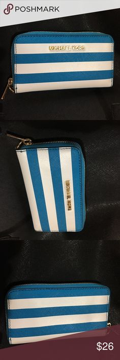 MK striped white and blue wallet Fits an iPhone 6 w/o a case  Missing the strap  In great condition  Might be a little dirty  But no visible flaws Michael Kors Bags Wallets