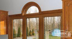Half-circle window above three-lite casement windows become a focal point in this kitchen. #homedesign #homeimprovement