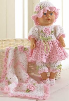 Original Crochet Pattern by: Maggie Weldon Skill Level: Easy Size: Fits doll; White (W): 2 ¾ oz, 198 yd g, 178 m); Pink (P): 2 Crochet Doll Dress, Crochet Doll Clothes, Crochet Doll Pattern, Doll Clothes Patterns, Doll Patterns, Crochet Patterns, Baby Doll Clothes, Barbie Clothes, Easy Crochet