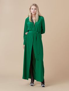 This floor length shirtdress stands alone or can be worn open over jeans. Features hidden button front closure and a self-tie belt. Cut in a fluid crepe with a soft sheen and gentle stretch.