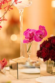Bright pink orchids add the perfect pop to modern @Mandy Dewey Seasons Resort The Biltmore Santa Barbara tablescapes.