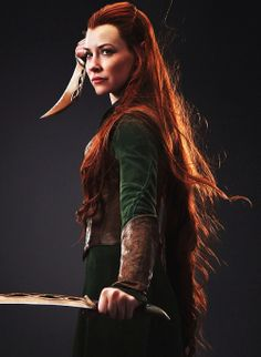 Tauriel... I never thought I would like her as much as I do! She is so pretty yet she kicks serious butt! Plus her and Kili are adorable together. << OTP!!