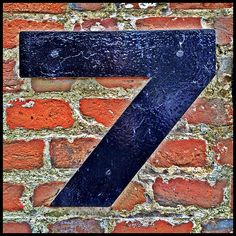 Number 7 on a red brick wall What's Your Number, Number 7, Lucky Number, Number Crafts, Lucky 7, Today Is My Birthday, Typography, Lettering, Alphabet And Numbers