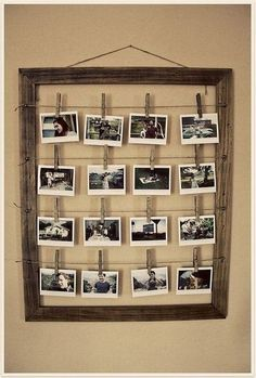 Display many photos with an old frame, wire, and clothespins