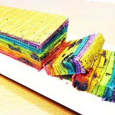 Rainbow Prune Kek Lapis: Sarawak kek lapis can take hours to cook as it's grilled layer by layer. In between grilling, each freshly-cooked layer is lightly pricked with a toothpick to get rid of air bubbles, and then flattened (with an icing smoother for example) to make sure the layer is level. #rainbowcake