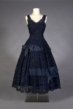 "Cocktail dress of navy blue lace with matching belt, French, ca. 1950, KSUM 1994.71.3 ab. This beautiful dress is currently on view in our ""Fashion Timeline""!"