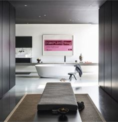 Freestanding bathtub from Antonio Lupi, stool by Perriand for Cassina