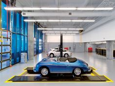 Sculpture in Motion: Porsche Experience Center by HOK | Vintage Porsches get worked on by mechanics in the training school. #design #interiordesignmagazine #interiors #projects #educationalspaces