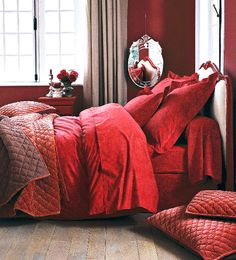 Red bedding and venetian mirror
