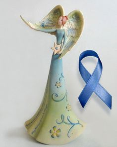 "The Peaceful Blessings Angel.This angel is an inspirational gift for the survivors of Colon Cancer. It's a symbol of strength and determination. She holds her wing up high to support all cancer survivors. Engraved in her wing are the words ""Peaceful Blessings"". She holds a star that symbolizes the united effort to battle colon cancer and the hope for a future without it! Message: You've aspired to challenges with great courage and determination. May blessings of peace be with you."