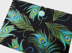 IPAD MINI 4 - IPAD - IPAD MINI - IPAD PRO - PEACOCK FEATHERS  This is a premium quality padded cover case that will help protect your favorite e-book reader from scratches, smudges, and dust. This padded cover case folds over so you can hold it in one hand while reading or put it on the table to watch your favorite movie.  **PLEASE NOTE: I make all my tablet and eReader covers with multiple layers of interfacing. This interfacing is individually cut for each section and then ironed to create…