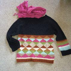 Strikket raglan sweater.