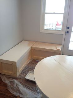 DIY Corner Bench for a Breakfast Nook or possiby a kids room under a window could work for storage an art station..