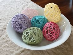 Make Yarn Easter Eggs using yarn dipped in Mod Podge and covering blown up balloons. After the glue dries, the balloon is popped leaving Yarn Easter Eggs.
