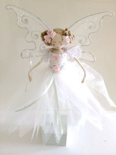 Our Fabulous Personalised Fairy makes a truly unique, magical gift for a little girl - perhaps to celebrate a birthday or other special event or just purely as a finishing touch to the decor of a bedroom. These are large fairy dolls approximately 16 in height and looks stunning hanging from a wall/door/bedpost or curtain pole. Alternatively she looks equally stunning on her dainty wooden stand where she can be displayed on a shelf or window ledge. Available in a choice of quality fa...